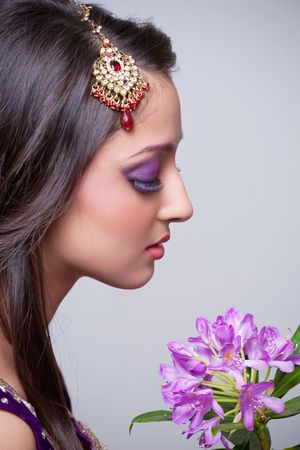 Closeup shot of beautiful asian bride with flowers photo