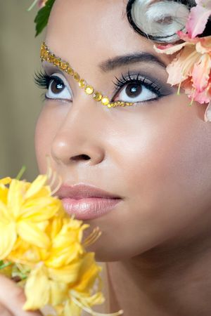 Closeup portrait of a beautiful young bride with curly hairstyle and fantasy makeup  photo