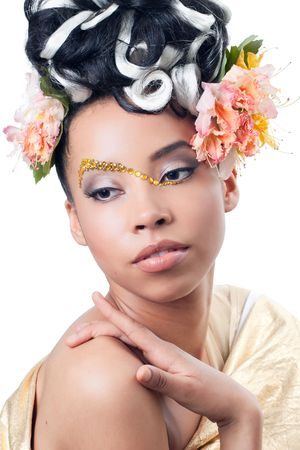Young beautiful woman with creative makeup and flower hairstyle photo
