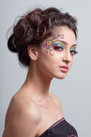 Beautiful young girl with colorful fantasy makeup  版權商用圖片