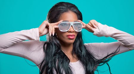 Positive young black woman, wearing fancy shutter shades sunglasses Stock Photo - 7917058