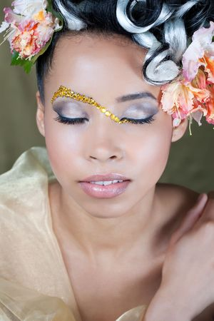 Closeup of beautiful model with creative bridal makeup photo