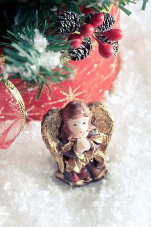 Christmas decoration - praying angel with golden wings Stock Photo - 8265608
