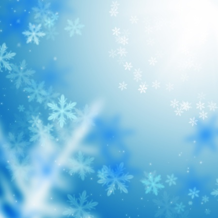 Beautiful blue winter background with snowflakes photo