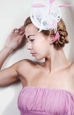 Young beautiful woman wearing a fancy hat photo