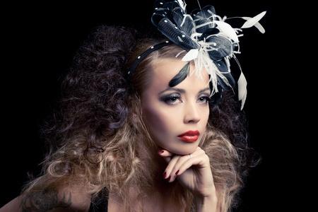 Beautiful fashion model, classic retro style look, isolated on black