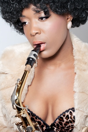 Beautiful saxophone player, retro style portrait, closeup shot Stock Photo - 8849263