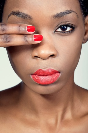 Closeup shot of a young woman with natural makeup and red lips