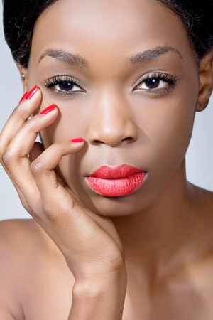 Closeup beauty shot of a young woman with natural eye makeup and red lips Stock Photo - 8849262