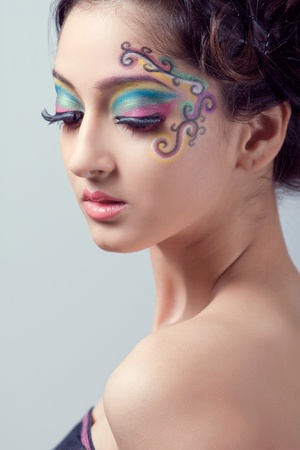 Beauty shot of a young woman with fantasy makeup photo