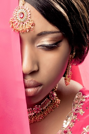 Beautiful indian woman wearing traditional clothes and jewelry, closeup shot