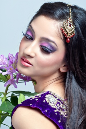 Beautiful indian woman with bridal makeup, closeup shot