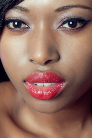 Closeup beauty shot of a young black woman with red lips Stock Photo - 9055025