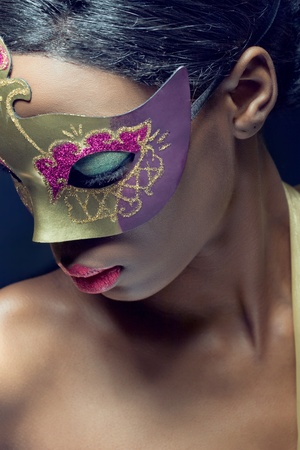 Closeup beauty portrait of a young black woman wearing mask photo