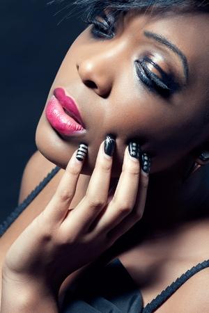 Beautiful young sensual woman with dark makeup, closeup shot Stock Photo