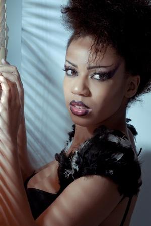Beautiful fashion model with creative demon style makeup photo