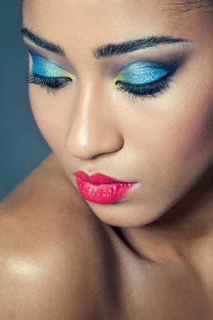 Beautiful young woman with colorful makeup, closeup shot
