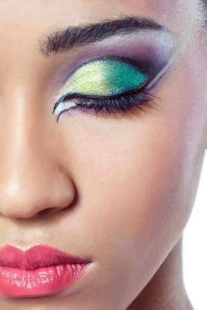Closeup shot of a beautiful young womans face with colorful makeup photo