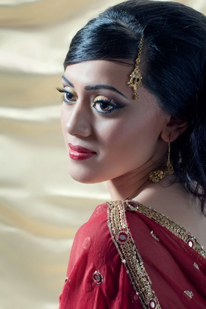Beautiful young asianindian woman wearing traditional clothes and jewelry photo