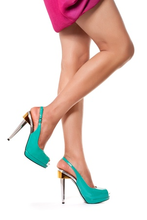 Closeup shot of young woman's legs in fashionable high heel turquoise shoes, on white Stock Photo - 9345087
