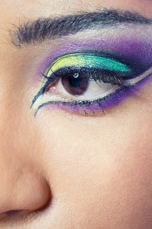 Closeup shot of a beautiful young womans eye with colorful makeup photo