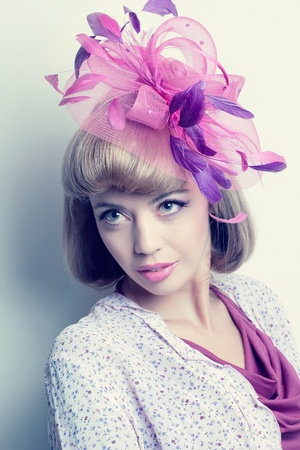 Young beautiful caucasian woman wearing a fancy hat with feathers, romantic style look photo
