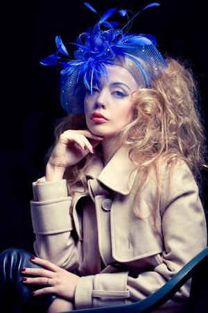 Beautiful fashion mode wearing blue hat, classic retro style look, studio portrait photo