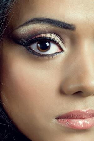 Closeup shot of a beautiful young asian womans face with perfect makeup