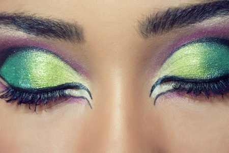eyeshadow: Closeup shot of a beautiful young womans face with colorful eye makeup