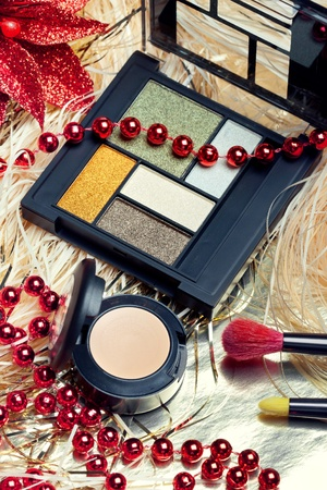concealer: Cosmetics for Christmas night makeup: an eyeshadow palette, concealer and brushes