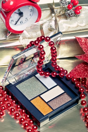 Cosmetics for Christmas night makeup: an eyeshadow palette, with christmas decorations photo