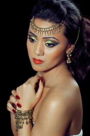 bridal makeup: Beautiful asianindian woman with bridal makeup and jewelry, closeup shot