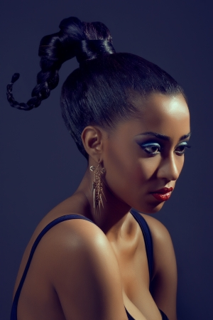 sleek: Portrait of beautiful woman with stylish creative hairstyle, on dark background Stock Photo