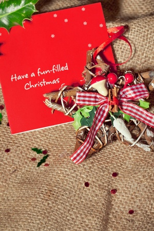 Christmas postcard with best wishes with rustic star shaped wreath decoration, closeup shot photo