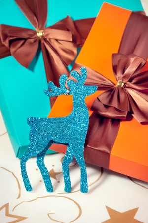 Two beautiful luxury Christmas present boxes with a reindeer decoration Stock Photo - 11431893