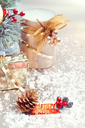 Christmas composition with gift box, candle and decorations, closeup shot, focus on the text photo