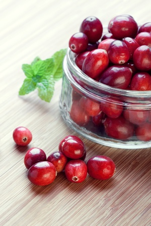 Cranberries in a glass jar, cloeseup shot, focus on the berries on the foreground Stock Photo