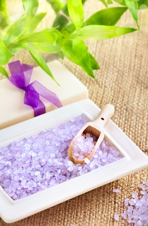 Spa and pampering: bath salt with soap and lucky bamboo, closeup shot, focus on salt and spoon photo