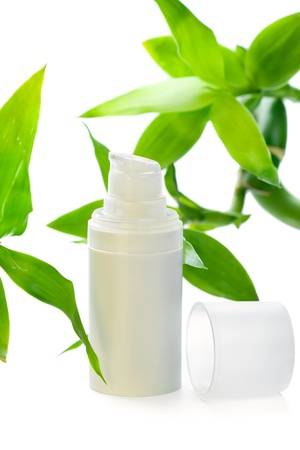 Face cream/serum/lotion/moisturizer among bamboo leaves, isolated on white Stock Photo - 11914716