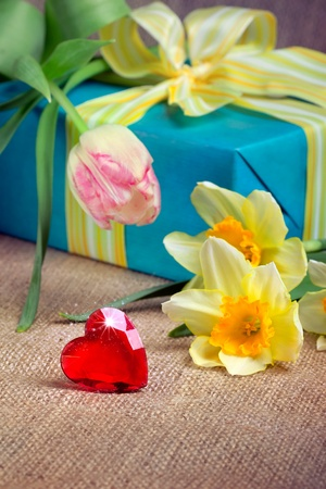 Red heart with a gift box and flowers, closeup shot, valentines daymothers day concept