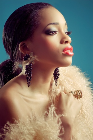Beautiful young black woman with dark eye makeup and red lips, classic retro style look, closeup shot  photo