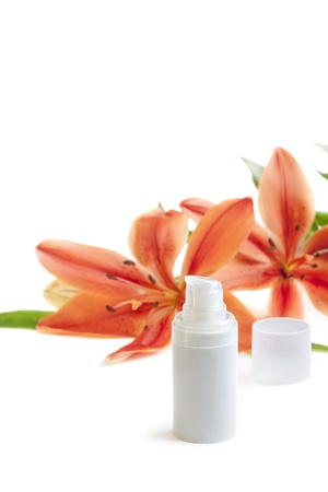 Face body care concept  cream lotion tube with lily flowers, closeup shot, on white Stock Photo - 12838587