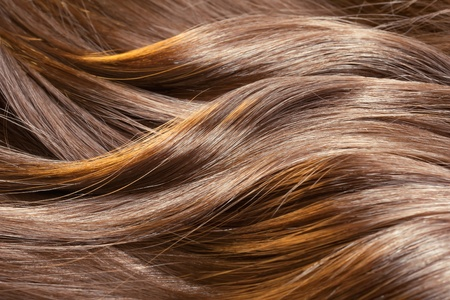 blonde streaks: Beautiful healthy shiny hair texture with highlighted golden streaks Stock Photo