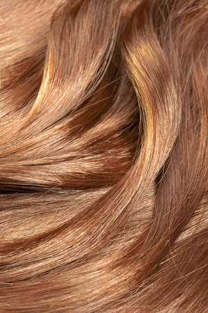 Beautiful healthy shiny hair texture with highlighted golden streaks  photo