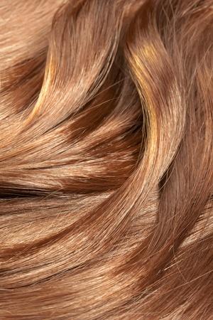 textura pelo: Hermosa textura de cabello sano y brillante, con vetas de oro destacadas Foto de archivo