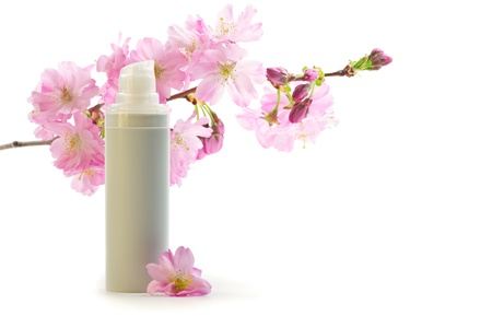 Daily skin care concept  face cream with sakura flowers
