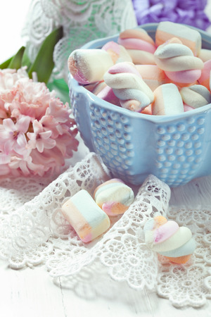 Pastel colored marshmallows in a bowl, closeup shot, toned photo photo