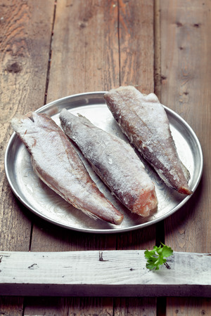gutted: Cooking from frozen  frozen gutted fish without head on a tray