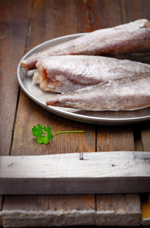 gutted: Cooking from frozen frozen gutted fish without head on a tray Stock Photo