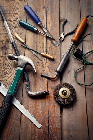 Set of old hand tools on wooden table, work or DIY hobby concept  photo